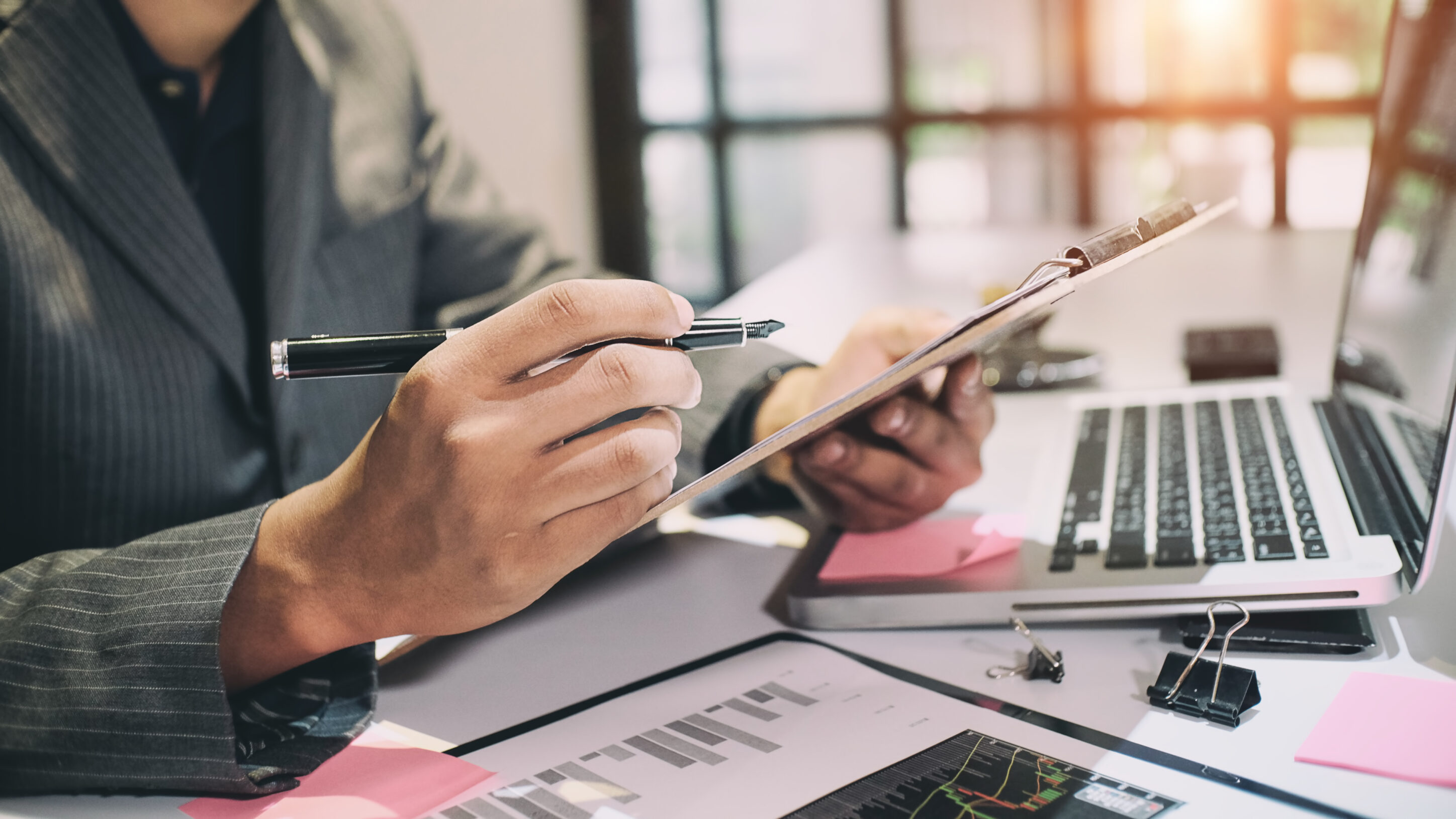Audit concept,Bookkeeper or financial inspector and secretary making report Financial Planning Report in Spreadsheet .Internal revenue Service inspector checking financial document vintage tone.