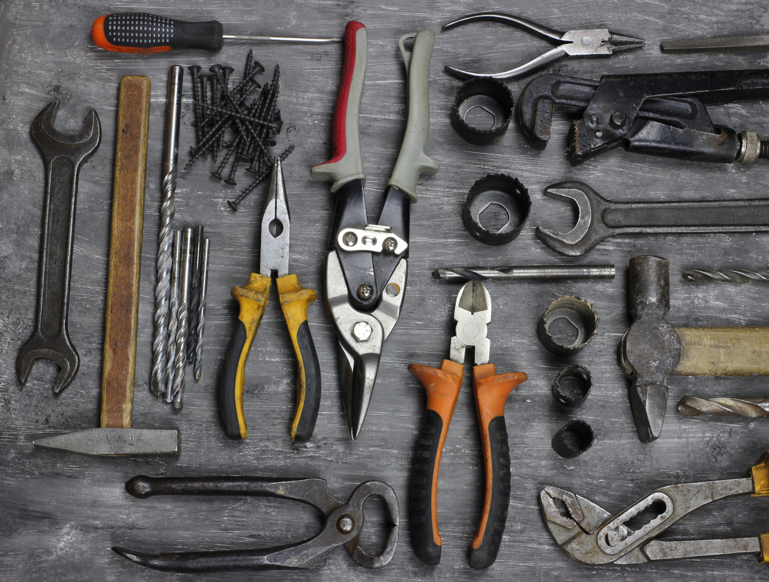 repairing implements for decorating and building renovation set in the wooden background. Top view